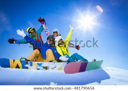 People with snowboards outdoors