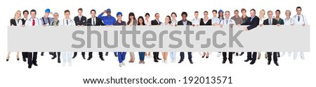 People with various occupations holding blank billboard against white background