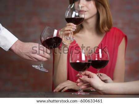 People with wine glasses at restaurant #600633461