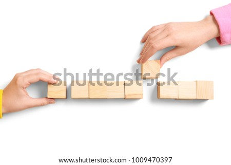 People with wooden cubes on white background. Unity concept #1009470397
