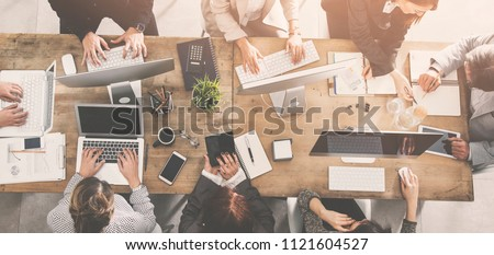 People working around a table