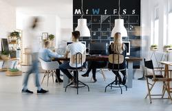 People working in modern, creative work environment