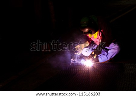 people working on the welding job in factory