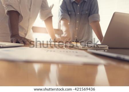 people working with business document together, selective focus and vintage tone #421569436
