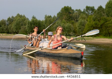 peoples traveling on canoe across the river