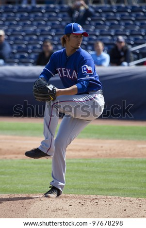 PEORIA, ARIZONA, USA - MARCH 7: Yu Darvish of the Texas Rangers throws his first pitch of Spring Training in Peoria, Arizona on March 7, 2012.