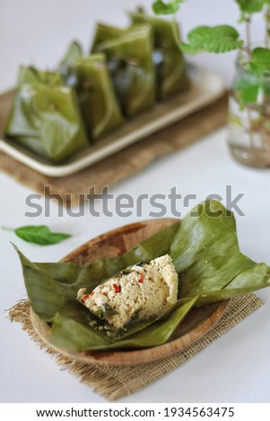 Pepes tahu or pepes tofu is an Indonesian cooking method using banana leaves as food wrappings. Selective focus  Foto d'archivio ©