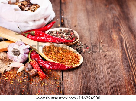 Pepper and spices on wooden background