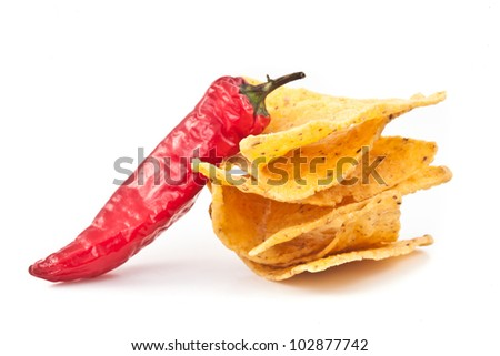 Pepper beside a small stack of crisps against white background