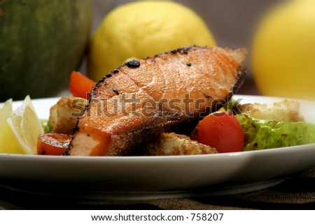 Pepper-crusted Salmon with panzanella and salad.