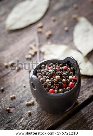 pepper in wooden background/ mixture of peppers hot pepper, red pepper, black pepper, white pepper, green pepper, background