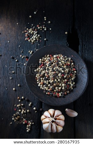 pepper in wooden background/ mixture of red pepper, black pepper, white pepper, green pepper