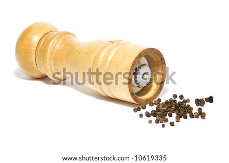 Pepper mill and black pepper isolated on white