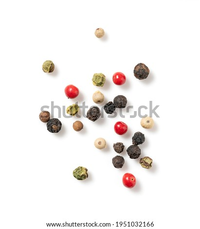Pepper mix. Black, red, white, and green peppercorns on a white background. View from directly above. Stock photo ©