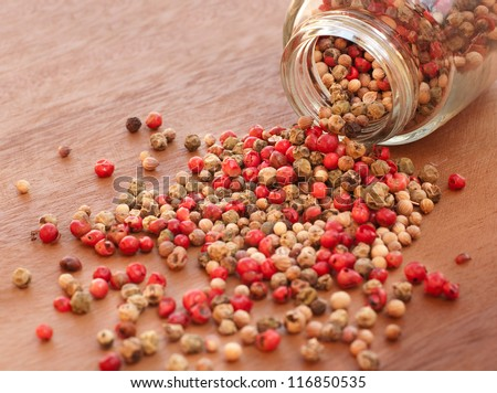 Pepper mix in a glass jar - stock photo