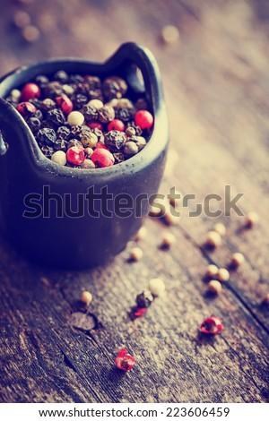 Pepper on wooden background/ mixture of peppers hot pepper, red pepper, black pepper, white pepper, green pepper, background