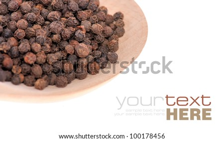 Pepper seeds in wooden spoon isolated on white background