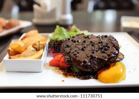 Pepper steak with vegetables on the white plate