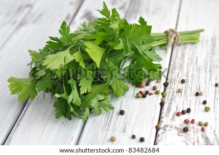 Peppercorn mix and fresh parsley on an old white table