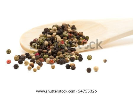 Peppercorns on wooden spoon over white background