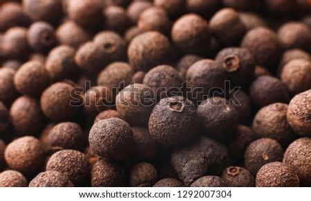 Peppercorns texture background, allspice, closeup #1292007304