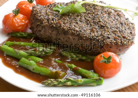 Peppered steak with gravy and vegetables