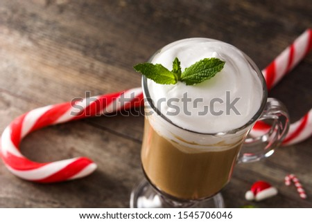 Peppermint coffee mocha for Christmas on wooden table. Copy space #1545706046
