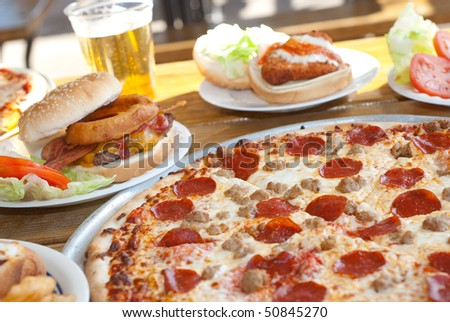 Pepperoni Pizza on Table with Food
