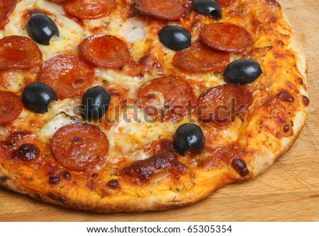 Pepperoni pizza with black olives. - stock photo