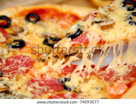 Pepperoni pizza with mushrooms, shrimps and olives background