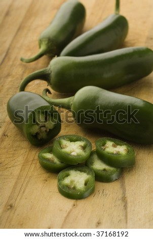 Peppers jalapeno peppers fresh raw wood background