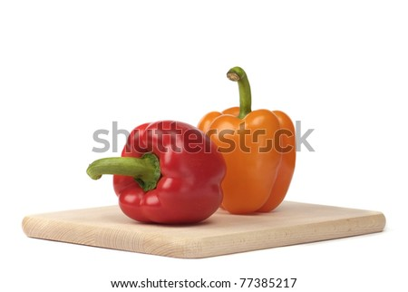 peppers on the board isolated on white