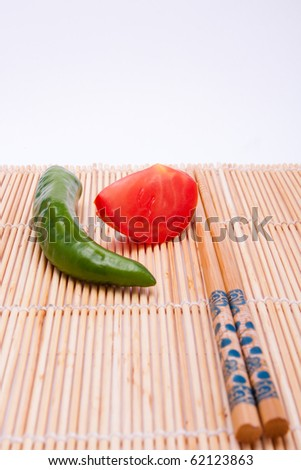 Peppers, tomatoes, sticks