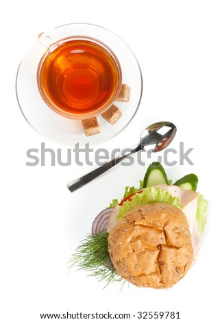 Percent symbol from ham sandwich and cup of tea on a white background. Close up.
