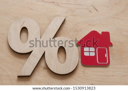 Percentage and house sign symbol icon wooden on wood table #1530913823