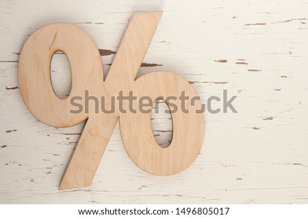 Percentage sign symbol icon on a white wooden background #1496805017
