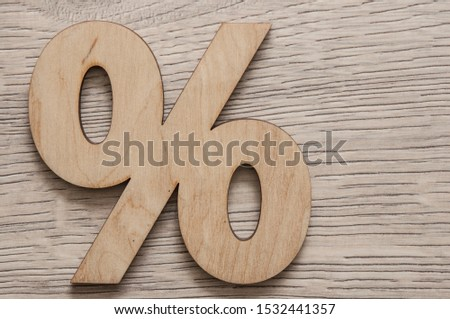 Percentage sign symbol icon on wood table, copy space #1532441357