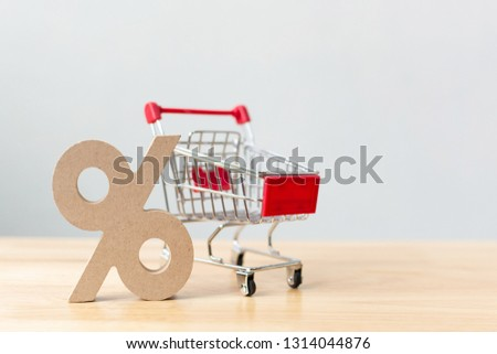 Percentage sign symbol icon wooden and shopping cart on wood table with white background #1314044876