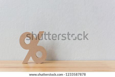Percentage sign symbol icon wooden on wood table with white background #1233587878