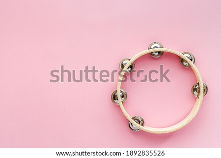 Percussion instrument tambourine, top view. Music background Stock photo ©