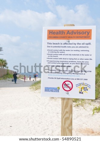 PERDIDO KEY - JUNE 9: A health hazard sign is shown posted on a popular vacation resort beach on June 9, 2010 in Perdido Key, Florida.  Oil threatens wildlife and tourism in the area.