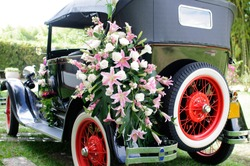 PEREIRA-COLOMBIA, MARCH 2012: Auto classic ford decorated with flowers for special occasion