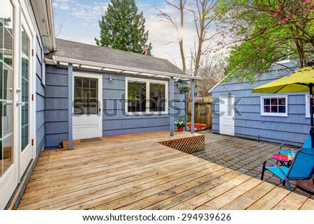 Perfect back deck with concrete patio, umbrella, and chairs. #294939626