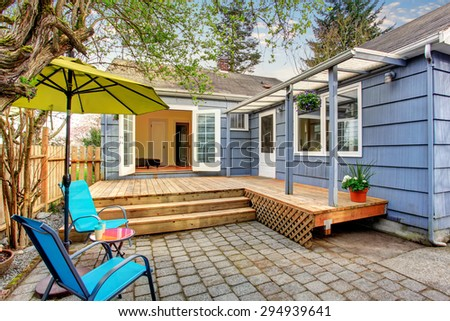Perfect back deck with concrete patio, umbrella, and chairs. #294939641