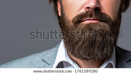 Perfect beard. Close-up of young bearded man. Close up of handsome beard hipster elegant male. Bearded man close up. Beard is his style. Closeup of bearded mans. Male with mustache growing.