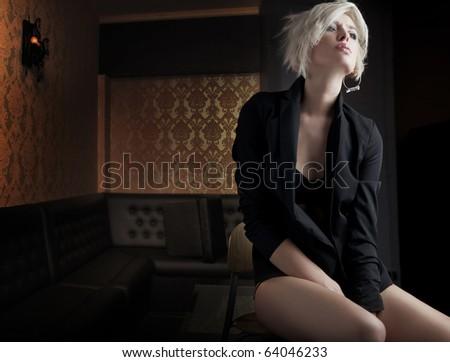Perfect beauty sitting in an empty nightclub - stock photo