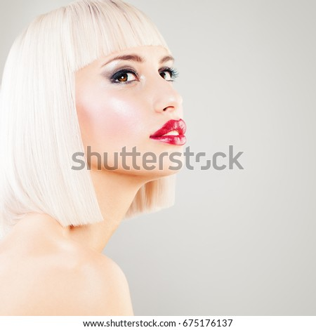 Perfect Blonde Woman Fashion Model with Colored Hair. Blondie Girl with Blonde Bob Hairstyle and Makeup Looking Up