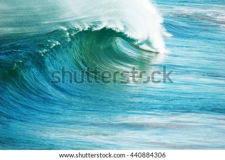 Perfect blue ocean surfing wave.