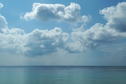 Perfect blue sky with clouds over the sea.
