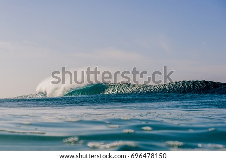 Perfect blue surfing waves of Portugal.  Europe on a beautiful day of off shore surf. #696478150